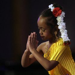 6 year old Tatsanee Pongpommard performs a Thai Buddhist dance during an interfaith musical tribute at the Salt Lake LDS Tabernacle in Salt Lake City, Utah, Sunday, Feb. 20, 2011.