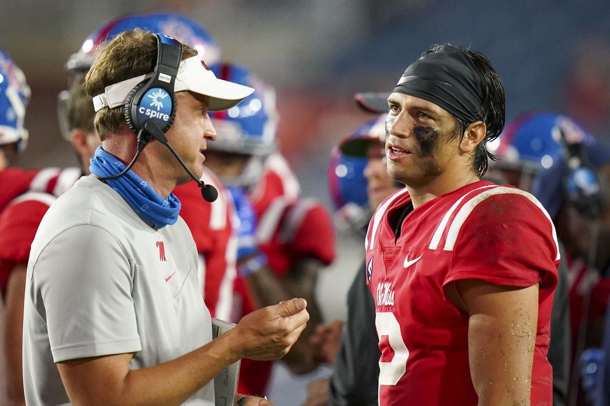 Mississippi Rebels quarterback Matt Corral talks with Mississippi Rebels head coach Lane Kiffin at Vaught-Hemingway Stadium.