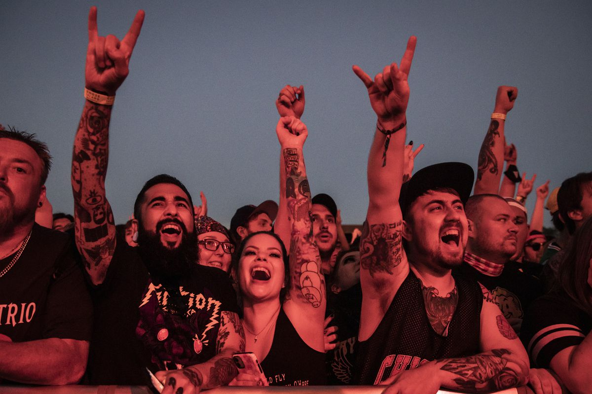 Fans cheer as Alkaline Trio performs at Riot Fest on Thursday night.