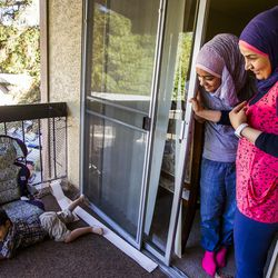 Nour Bilal, 15, left, and her mother, Kholoud Abou Arida, watch Zain Bilal, 3, play at their home in Millcreek on Tuesday, Sept. 8, 2015.