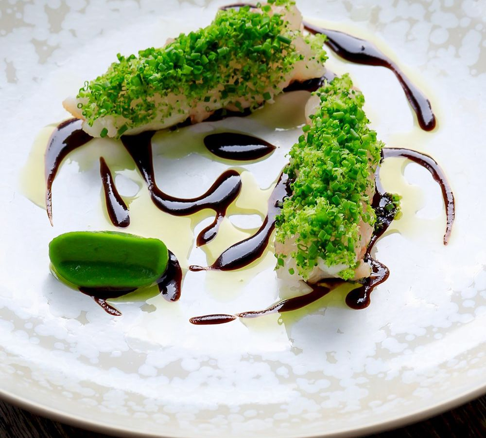 Large chunks of langoustine are buried in diced broccoli and onion, sitting in elegant swirls of oil and vinegar
