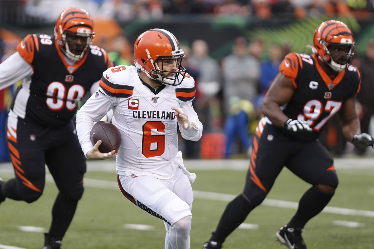 Cleveland Browns quarterback Baker Mayfield runs with the ball against the Cincinnati Bengals during the first half at Paul Brown Stadium.