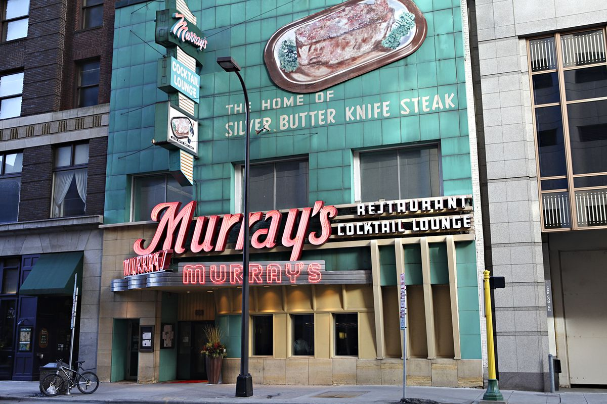Murray's Steakhouse exterior with a red neon sign