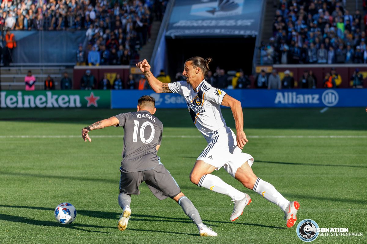 October 21, 2018 - Minneapolis, Minnesota, United States - Minnesota United midfielder Miguel Ibarra (10) and LA Galaxy forward Zlatan Ibrahimovic (9) chase after a loose ball during the match at TCF Bank Stadium.