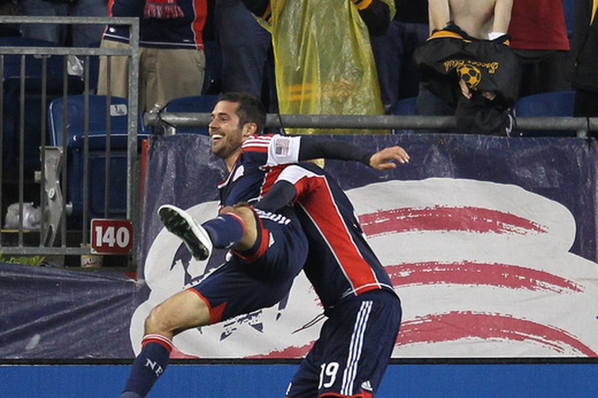 FOXBORO, MA - JUNE 2:  Benny Feilhaber #22 of the New England Revolution celebrates his goal with teammate Saer Sene #19 against the Chicago Fire at Gillette Stadium on June 2, 2012 in Foxboro, Massachusetts. (Photo by Jim Rogash/Getty Images)