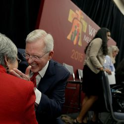 """Elder D. Todd Christofferson of the Quorum of the Twelve Apostles of The Church of Jesus Christ of Latter-day Saints speaks with a woman after presenting """"Techniques for Family Unity from Mormon Homes"""" at the World Meeting of Families in Philadelphia on Thursday, Sept. 24, 2015."""