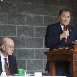 President Henry B. Eyring, first counselor in the First Presidency of the Church of Jesus Christ of Latter-day Saints, left, looks on as Gov. Gary Herbert, right, speaks before President Eyring dedicated the Thomas S. Monson Lodge at the Hinckley Scout Ranch in the Uinta Mountains on Wednesday, Oct. 5, 2016.