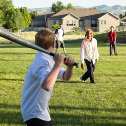 Clayson, 10, and Casey, 13, play baseball in the backyard. They say they like having such a big family because there are more people to play with.