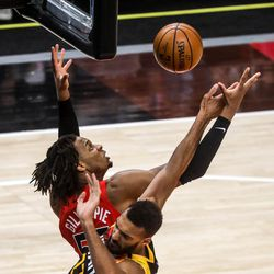 Utah Jazz center Rudy Gobert (27) fights Toronto Raptors forward Freddie Gillespie (55) for the ball during an NBA basketball game at Vivint Smart Home Arena in Salt Lake City on Saturday, May 1, 2021.