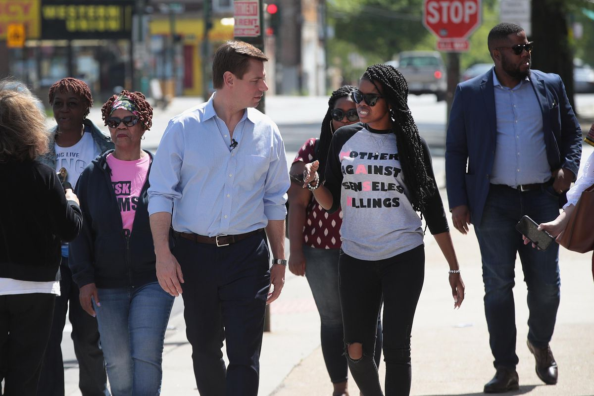 Democratic presidential candidate Congressman Eric Swalwell (D-CA) speaks with community activist and founder of Mothers Against Senseless Killings (MASK) Tamar Manasseh.