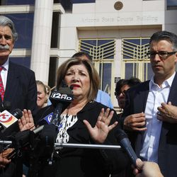 Mary Rose Wilcox, center, a Maricopa County Board of Supervisors member who had a criminal case brought against her by then-Maricopa County Attorney Andrew Thomas, speaks in front of the Arizona State Courts building after an ethics panel moved to disbar Thomas Tuesday, April 10, 2012, in Phoenix. , Her husband Earl Wilcox, left, and Randy Parraz, president of Citizens For A Better Arizona, listen.  An Arizona ethics panel ruled to disbar Maricopa County's former top prosecutor for failed corruption investigations he and America's self-proclaimed toughest sheriff conducted targeting officials with whom they were having political and legal disputes.