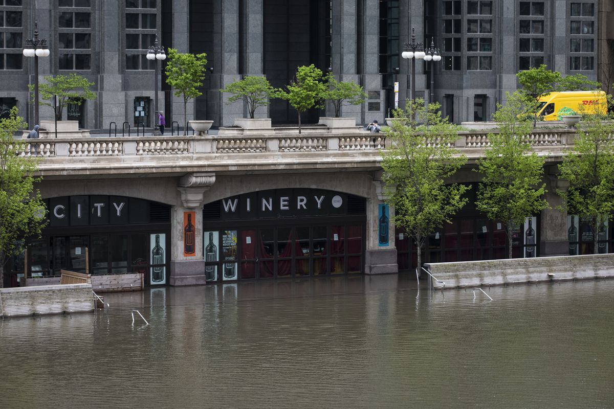 The Chicago River overflowed its banks and flooded the Riverwalk after overnight showers and thunderstorms across the city Monday, May 18, 2020 in Chicago. (Ashlee Rezin Garcia/Chicago Sun-Times via AP) ORG XMIT: ILCHS307