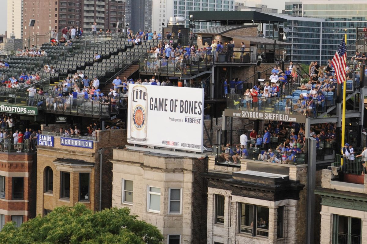 """These are the rooftop views that are going to be blocked by the Cubs' right-field board. The Miller sign seen here is currently vacant, with a """"for rent"""" sign on it"""