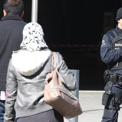 A Belgian police officer patrols outside the Gare du Midi train station in Brussels, Tuesday, March 22, 2016. Explosions, at least one likely caused by a suicide bomber, rocked the Brussels airport and its subway system Tuesday, prompting a lockdown of the Belgian capital and heightened security across Europe.