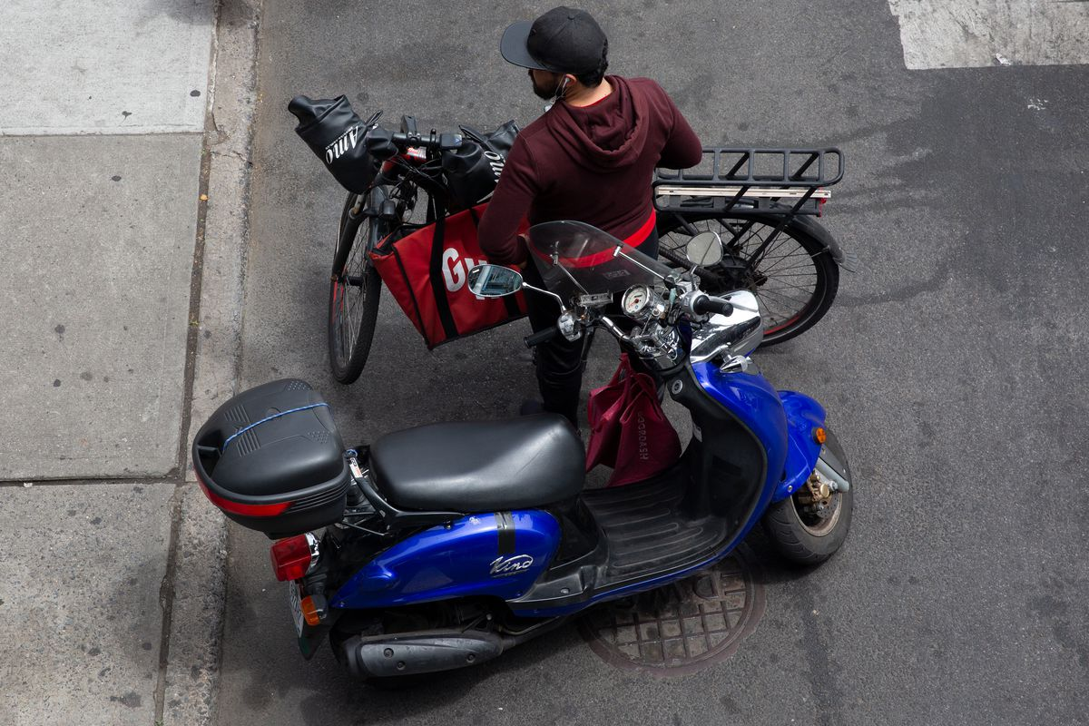 A delivery worker takes a break in Bensonhurst, Brooklyn, May 24, 2021.