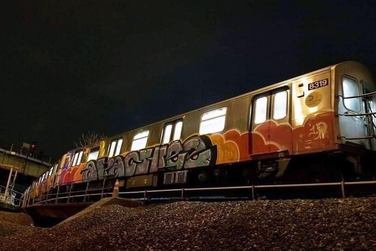 A graffiti-tagged train sits in a train yard at 207th Street in March, 2019.