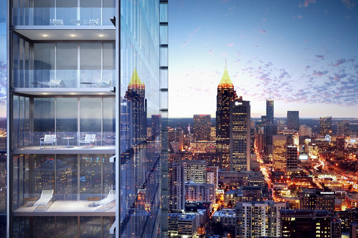 A cut of the sleek glass tower, with the downtown skyline beyond.
