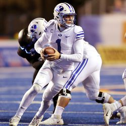Brigham Young Cougars quarterback Zach Wilson (1) takes the snap and spins to deliver a pass as BYU and Boise State play a college football game at Albertsons Stadium in Boise on Friday, Nov. 6, 2020. BYU won 51-17.