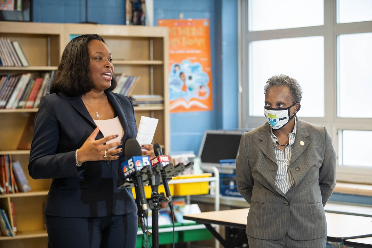 Chicago Public Schools CEO Dr. Janice Jackson speaks while Mayor Lori Lightfoot listens during a press conference at King Academy of Social Justice in Englewood on the first day of the fall semester.
