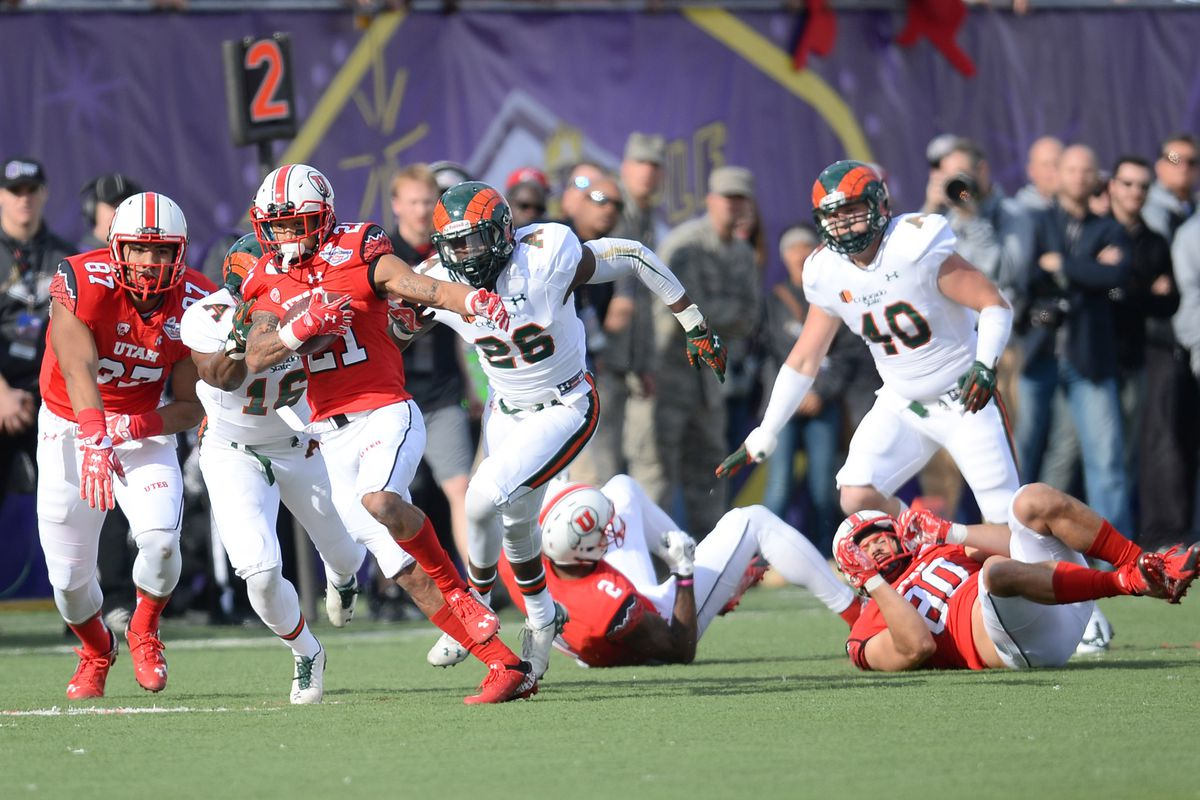 Dec 20, 2014; Las Vegas, NV, USA; Utah Utes running back Troy McCormick (21) rushes the ball against the Colorado State Rams during the first half of the Las Vegas Bowl at Sam Boyd Stadium.