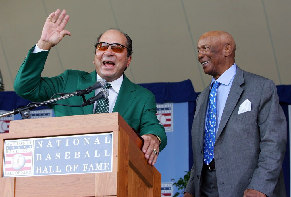 Hall of Famers Johnny Bench (L) and Ernie Banks have a laugh at Clark Sports Center during the Baseball Hall of Fame induction ceremony on July 27, 2008 in Cooperstown, New York.  (Photo by Jim McIsaac/Getty Images)