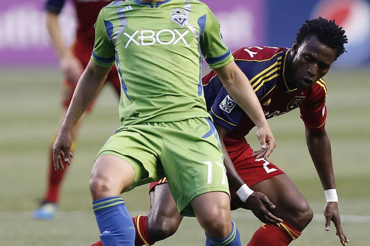 SANDY, UT - JULY 4: Fredy Montero #17 of the Seattle Sounders holds off Kenny Mansally #29 of Real Salt Lake during the first half of an MLS soccer game July 4, 2012 at Rio Tinto Stadium in Sandy, Utah.(Photo by George Frey/Getty Images)