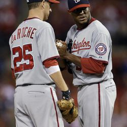 Washington Nationals starting pitcher Edwin Jackson, right, talks on the mound with Adam LaRoche during the first inning of a baseball game against the St. Louis Cardinals on Friday, Sept. 28, 2012, in St. Louis.
