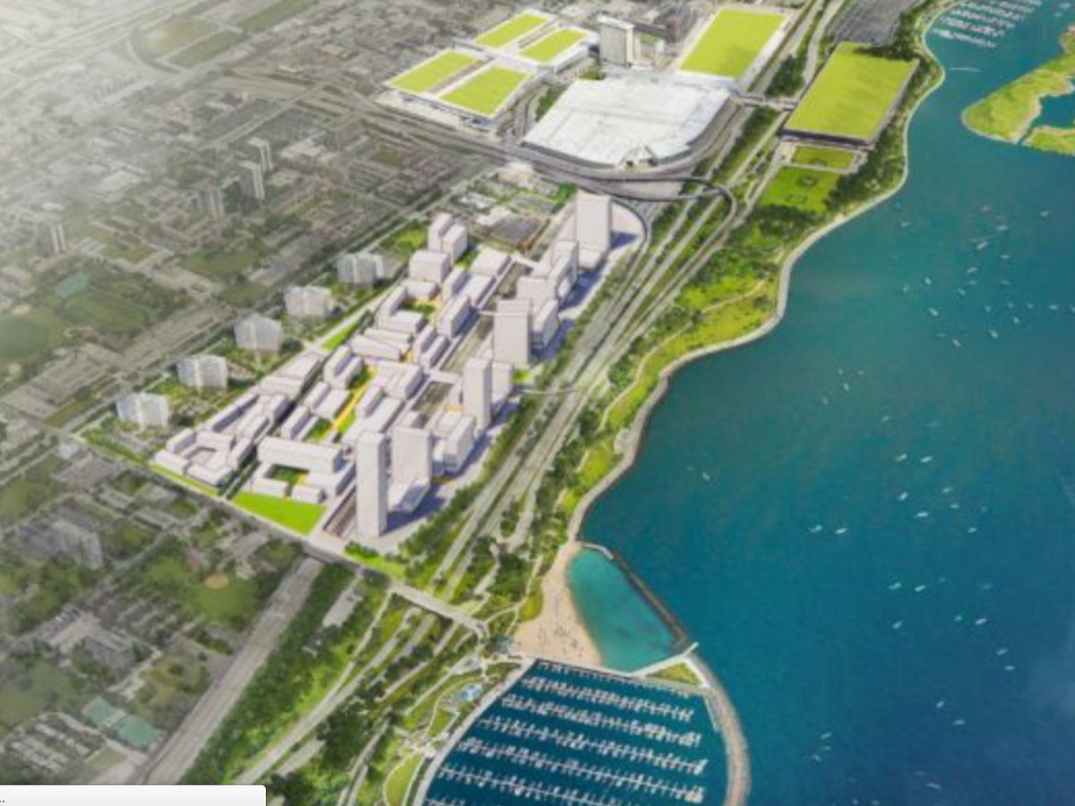 An aerial renderings showing a cluster of low and high-rise buildings lining Lake Shore Drive next to Lake Michigan.