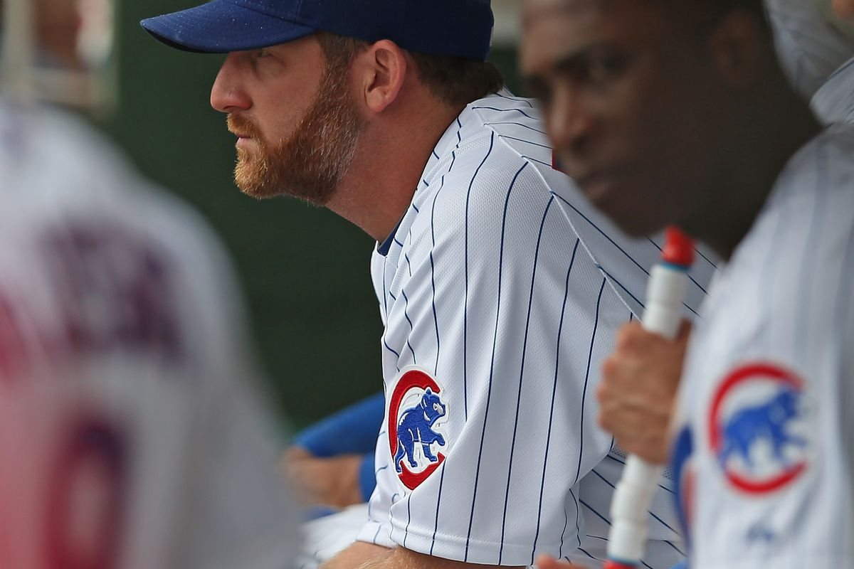 Ryan Dempster of the Chicago Cubs watches from the dugout as the Cubs take on the St. Louis Cardinals at Wrigley Field in Chicago, Illinois. (Photo by Jonathan Daniel/Getty Images)