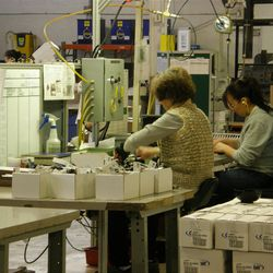 Workers assembling irrigation products at Orbit Irrigation Products, Inc. in North Salt Lake, Utah.
