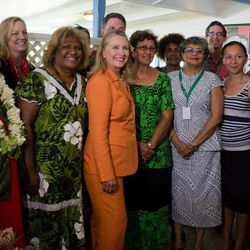 """U.S. Secretary of State Hillary Rodham Clinton, center, poses with female participants of the """"Dialogue on Gender Equality"""" in Rarotonga, Cook Islands, Friday, Aug. 31, 2012."""