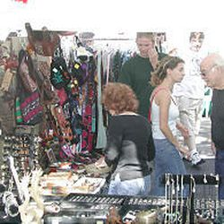 People look at merchandise offered in booths during the Avenues Street Fair. The 2005 event is Saturday, Sept. 10, between Q and Virginia Streets on South Temple.