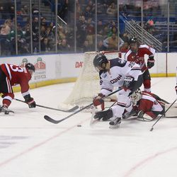 UConn's Joey Ferriss (28) tries to backhand a shot on goal.