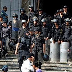 Egyptians security forces provide a cordon around the al-Fatah mosque, after hundreds of Muslim Brotherhood supporters barricaded themselves inside the mosque overnight, following a day of fierce street battles that left scores of people dead, near Ramses Square in downtown Cairo, Egypt, Saturday, Aug. 17, 2013. Authorities say police in Cairo are negotiating with people barricaded in a mosque and promising them safe passage if they leave. Muslim Brotherhood supporters of Egypt's ousted Islamist president are vowing to defy a state of emergency with new protests today, adding to the tension.