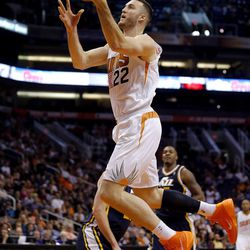 Phoenix Suns' Miles Plumlee (22) shoots against the Utah Jazz during the second half of an NBA basketball game on Friday, Nov. 1, 2013, in Phoenix. The Suns won 87-84.