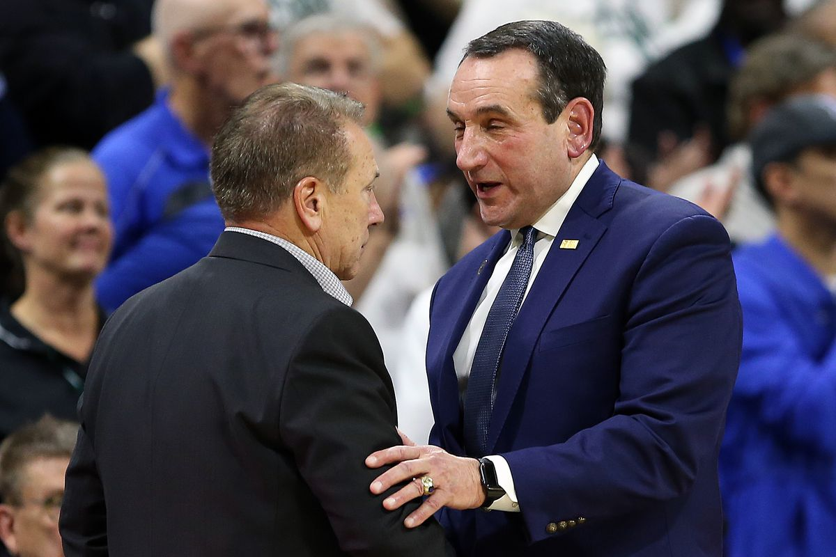 Michigan State Spartans head coach Tom Izzo and Duke Blue Devils head coach Mike Krzyzewski shake hands at mid court during the second half of a game at Breslin Center.