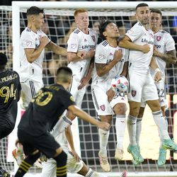 Los Angeles FC midfielder Eduard Atuesta (20) makes a free kick as members Real Salt Lake attempt to block during the first half of a Major League Soccer match Saturday, July 17, 2021, in Los Angeles.