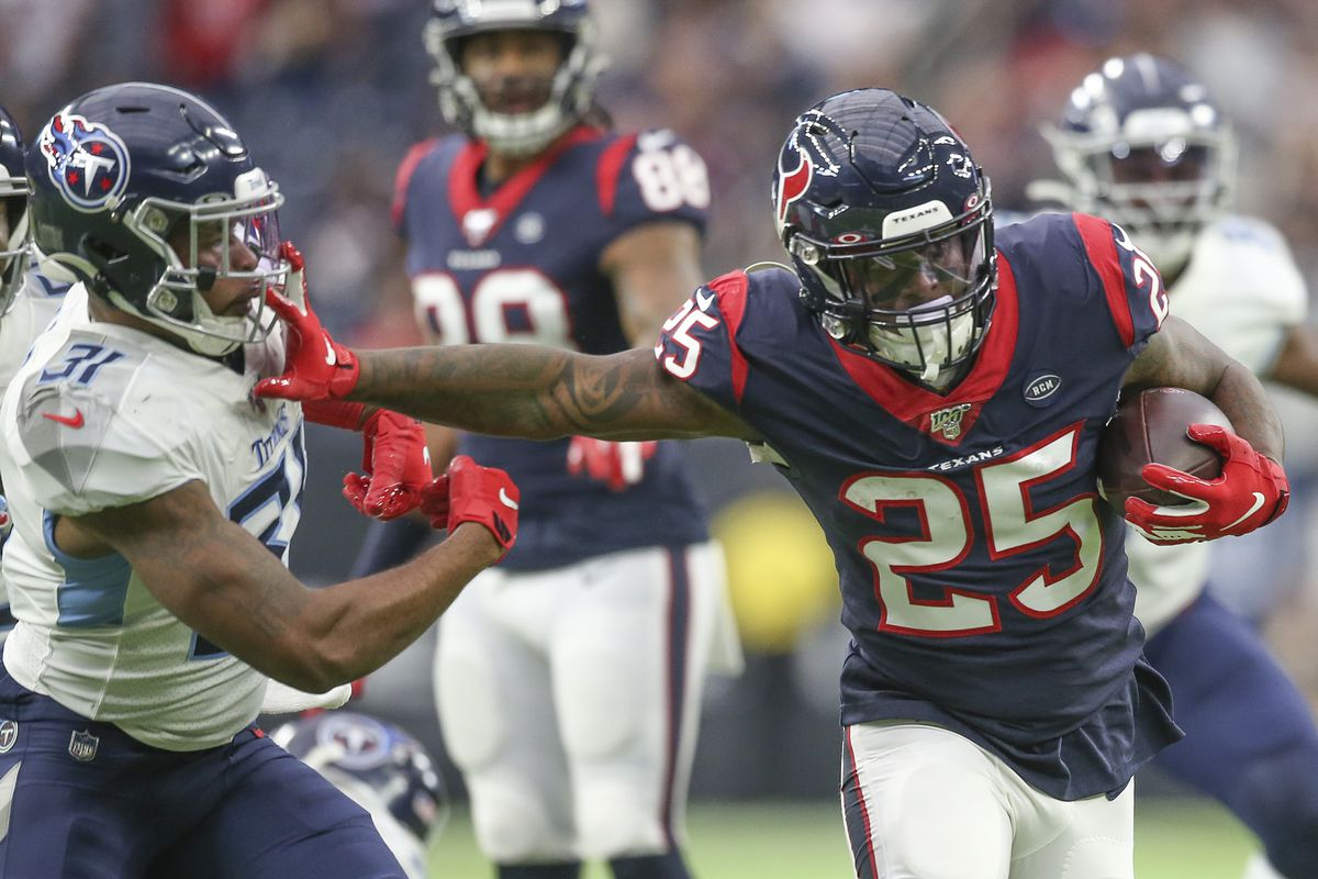 Houston Texans running back Duke Johnson stiff arms Tennessee Titans free safety Kevin Byard in the first quarter at NRG Stadium.