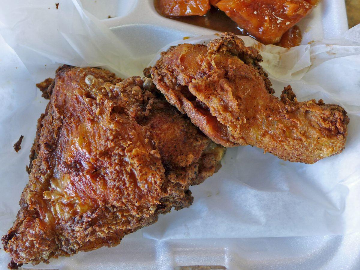 Two pieces of dark fried chicken