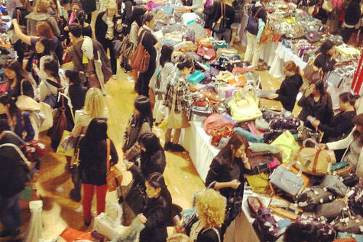 "An ariel shot of the mayhem at Rebecca Minkoff's NYC sample sale. Image via Rebecca Minkoff/<a href=""http://instagr.am/p/KbJX8ARYlq/"">Instagram</a>."