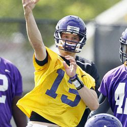 In this Wednesday, April 11, 2012 photo,  East Carolina quarterback Cody Keith passes during football practice in Greenville, N.C. With Dominique Davis gone, East Carolina has an open race for its starting quarterback job.