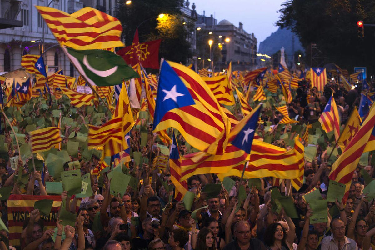 FILE - Demonstrators wave Catalan flags during a protest rally in Barcelona , Spain, in this Tuesday, Sept. 11, 2012 file photo. Thousands of people demonstrated in Barcelona on Tuesday demanding independence for Catalonia, on the Catalonia region's 'Nati