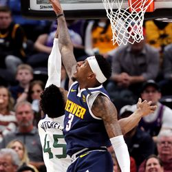 Denver Nuggets forward Torrey Craig (3) blocks Utah Jazz guard Donovan Mitchell (45) at the hoop as the Utah Jazz and the Denver Nuggets play an NBA basketball game at Vivint Arena in Salt Lake City on Wednesday, Feb. 5, 2020. Denver won 98-95, giving the Jazz their fifth straight loss.