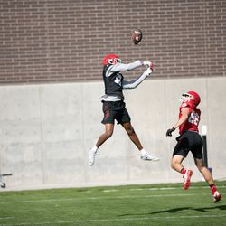 Utah safety Zemaiah Vaughn, left, defends a pass during practice in Salt Lake City on Saturday, Oct. 10, 2020.