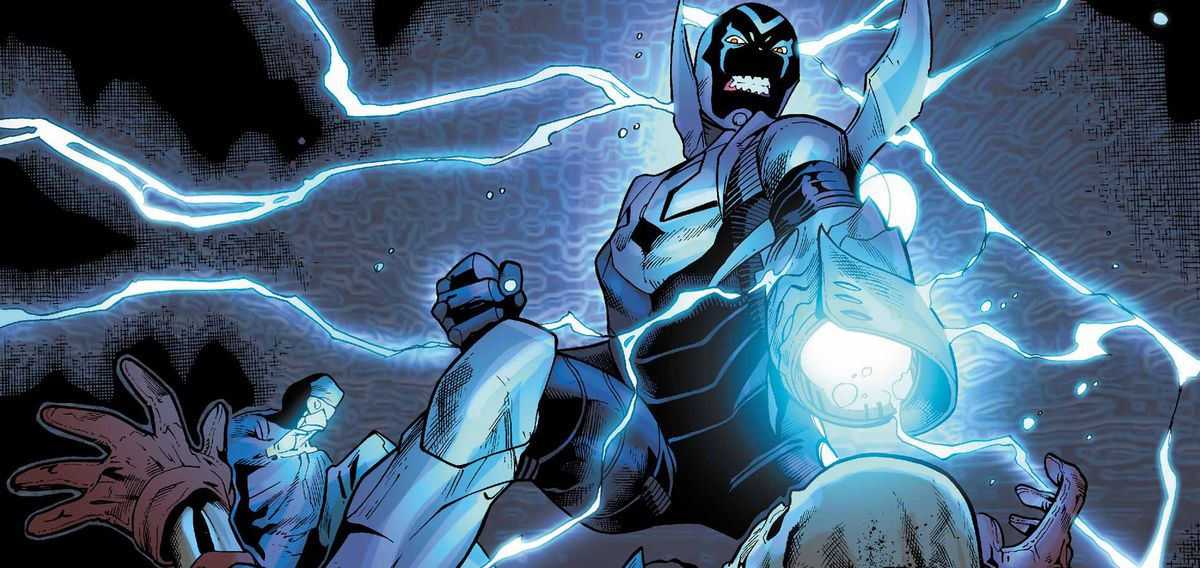 Blue Beetle in flight, firing his arm cannon.