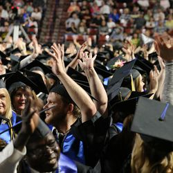 Students listen during Salt Lake Community College's commencement ceremony at the Maverik Center in West Valley City on Friday, May 6, 2016.