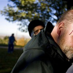 Rob Watts of Kaysville poses as a victim as part of a mock disaster drill in Centerville on Saturday.