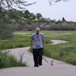 Jerry Sloan goes for one of his daily four-mile walks with his dog Max near his home in Riverton. Sloan, who was inducted into the NBA Hall of Fame in 2009, was diagnosed in 2015 with Parkinson's disease and Lewy body dementia.