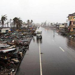 Debris covers the landscape in Tacloban, Friday, Nov. 22, 2013.