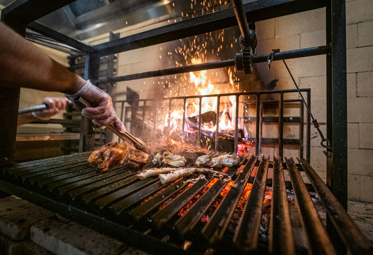 An Argentine-style at Ruthie's All Day gaucho grill fires everything from chicken to octopus